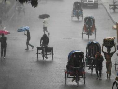 it rains in Dhaka, Bangladesh, Monday. AP