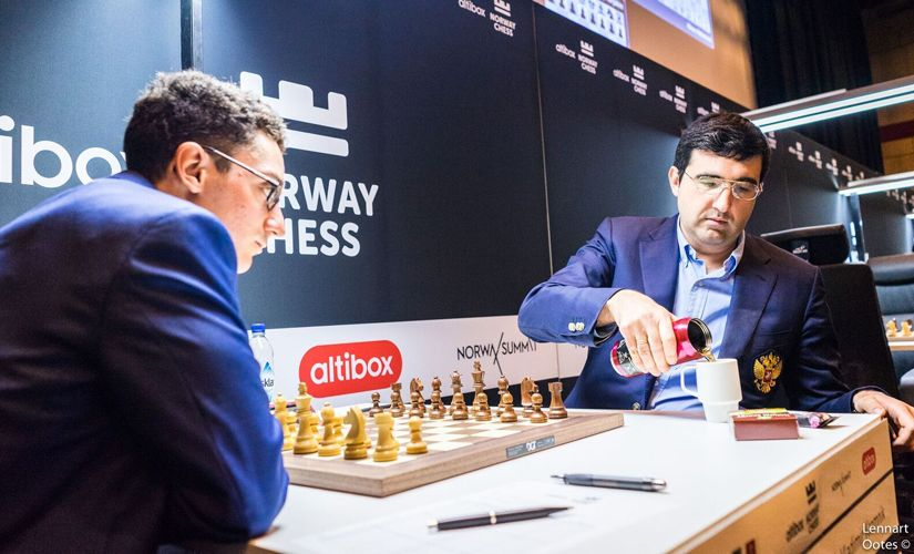 Caruana pressed hard against Kramnik, but the Russian with his secret drink did not budge. Image courtesy Lennart Ootes