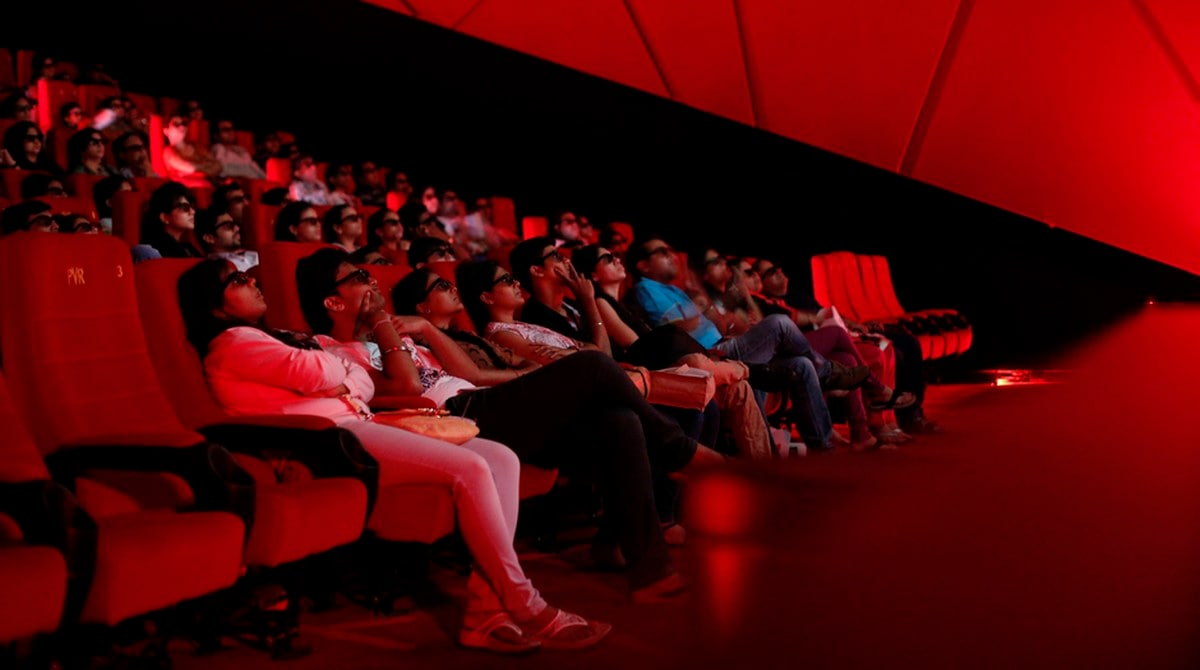 Cinema-goers wearing 3D glasses watch a movie at a PVR Multiplex in Mumbai November 10, 2013. Multiplex operators like PVR Ltd, Inox Leisure, Reliance Mediaworks and Mexican chain Cinepolis are scrambling to set up theatres targeting the rapidly growing number of middle-class Indians willing to pay to watch Bollywood movies in more comfortable surroundings. The potential is huge, provided operators can find the right location in a country where prime urban real estate is costly and in short supply. Picture taken November 10, 2013. To match MULTIPLEX-INDIA/ REUTERS/Danish Siddiqui (INDIA - Tags: SOCIETY BUSINESS ENTERTAINMENT) - RTX15KPF