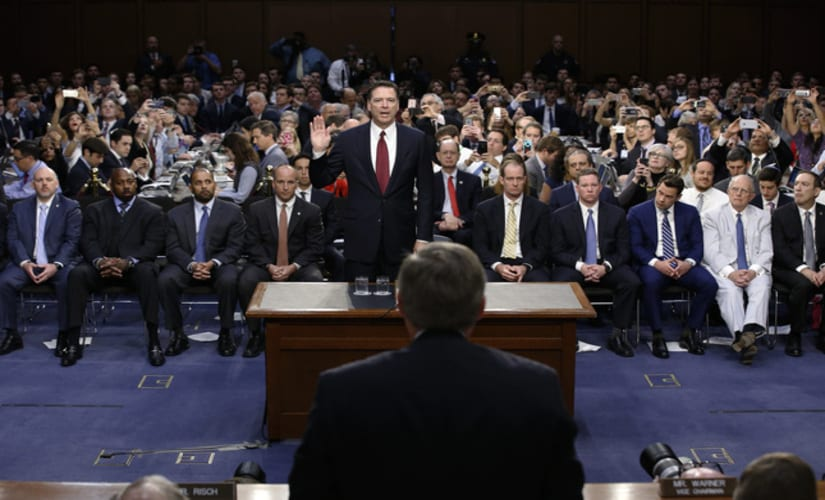 James Comey takes oath before his testimony/ Reuters