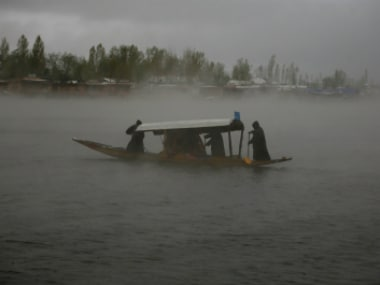 People row a boat in the waters of Dal Lake as it rains in Srinagar (representational photo). Reuters