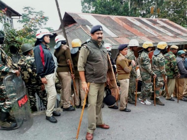 Darjeeling: Security personnel stand guard as the supporters of the Gorkha Janmukti Morcha (GJM) call for an indefinite bandh for a separate state of Gorkhaland in Darjeeling Hills on Thursday. PTI