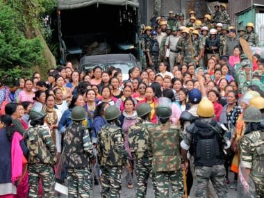 Security forces personnel trying to control woman Gorkha Janamukti Morcha supporters during a protest at their office Patlebash in Darjeeling on Thursday. PTI