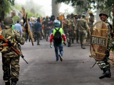 Security forces personnel during clashes with Gorkha Janamukti Morcha supporters in Darjeeling on Thursday. PTI