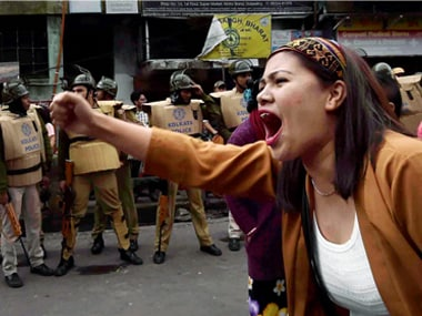 A GJM supporter shouts slogans at a protest rally in Darjeeling. PTI