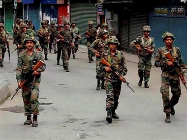 CRPF troops patrol the streets a day after GJM (Gorkha Janmukti Morcha) supporters resorted to violence in Darjeeling. PTI