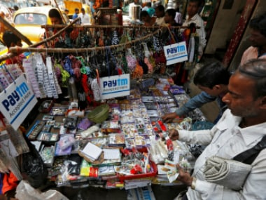 Advertisements of Paytm, a digital wallet company, are seen placed at a road side stall in Kolkata (representational photo). Reuters