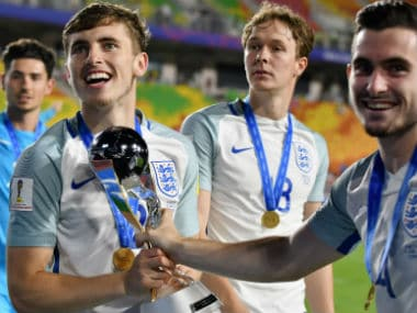 England players celebrate with the Fifa Under-20 World Cup after their win over Venezuela. AFP