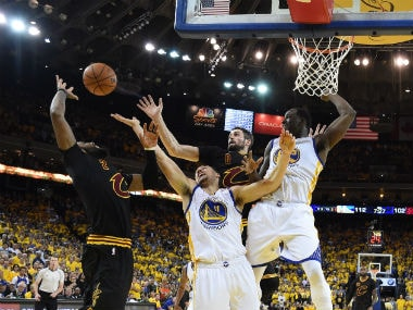 Golden State Warriors and Cleveland Cavaliers players in action during the 4th quarter in game five of the 2017 NBA Finals. Reuters