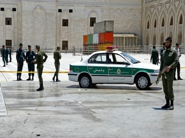 Police officers control the scene in Iran. AP