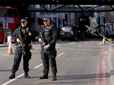 Two armed police guard an area near Borough Market in the London Bridge area of London on Monday. AP