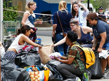 People donate articles of food, clothing and household items for those made homeless by the massive fire in Grenfell Tower, in London, Thursday