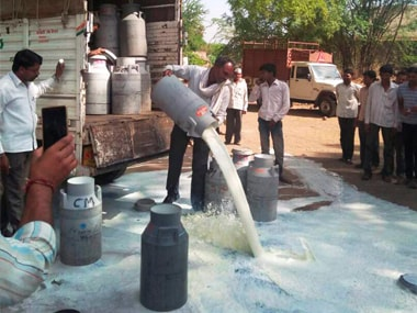 File image of farmers in Aurangabad spilling out milk on a road during their state-wide protest. PTI
