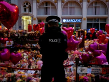 People attend a vigil for the victims of attack at a pop concert at Manchester Arena, in central Manchester. Reuters