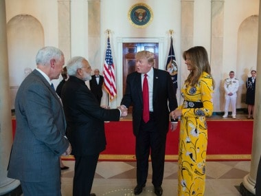 Narendra Modi with Donald and Melania Trump. Twitter/PMOIndia
