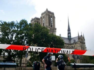 Police officers seal access to Notre Dame cathedral in Paris. AP