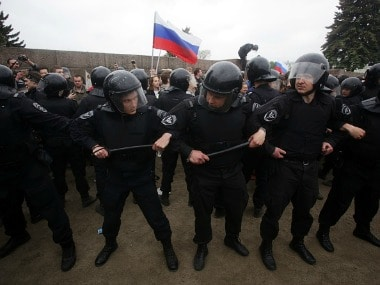 Police detain protesters during an unauthorised protest in Russia. Getty Images