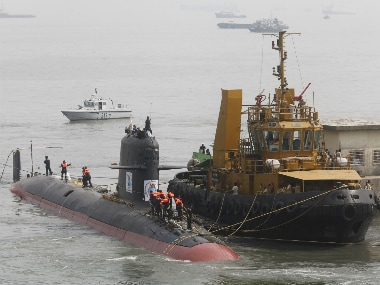 File photo of Indian Navy's Scorpene submarine INS Kalvari being escorted by tugboats as it arrives at Mazagon Docks Ltd in Mumbai. Reuters
