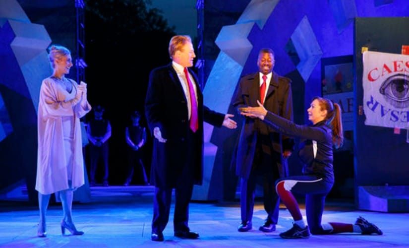In this file image provided by The Public Theater, Tina Benko, left, portrays Melania Trump and Gregg Henry, center left, portrays President Donald Trump in the role of Julius Caesar during a dress rehearsal in New York. AP