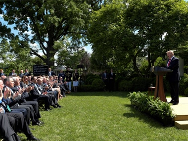 US Ppesident Donald Trump is applauded as he announces that the US will withdraw from the Paris climate change accord during a statement in the Rose Garden of the White House in Washington, on Thursday. AP