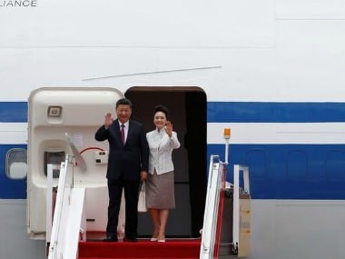 Chinese President Xi Jinping and his wife Peng Liyuan arrive at the airport in Hong Kongon Thursday. Reuters