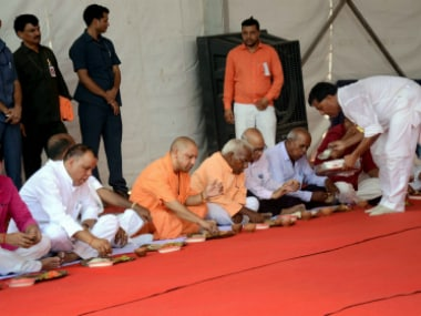 Yogi Adityanath having meal at the unveiling of the statue of Dr BR Ambedkar at Campierganj in Gorakhpur on Wednesday. PTI