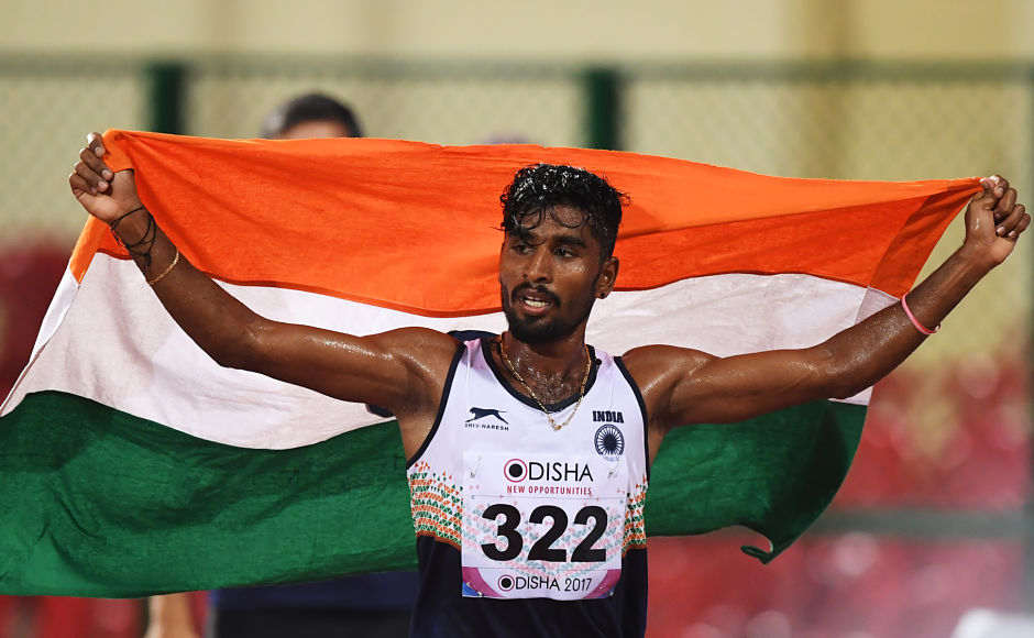 G Lakshmanan celebrates after winning the Gold medal in the men's 5000m run on the first day of the 22nd Asian Athletics Championships at Kalinga Stadium in Bhubaneswar.AFP