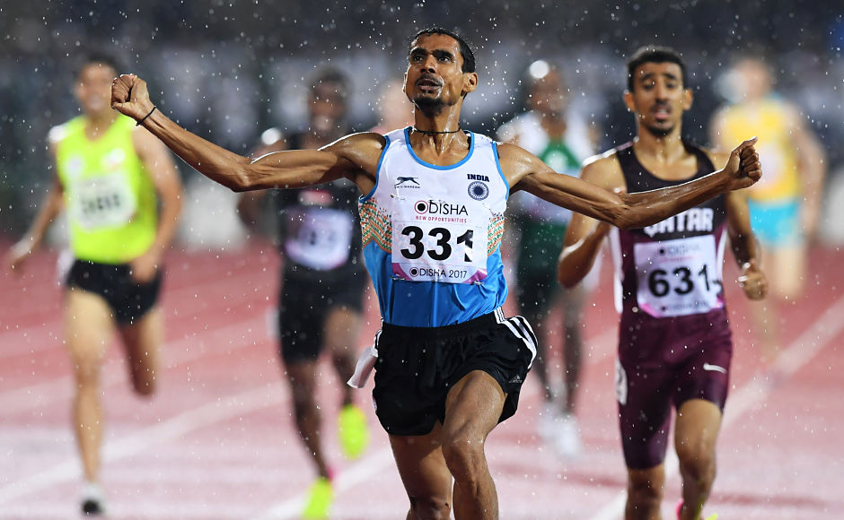 Ajay Kumar Saroj celebrates after winning the gold medal in the mens 1500m event. AFP