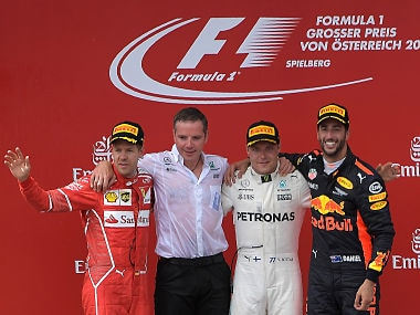 Ferrari's German driver Sebastian Vettel (1st-L), Mercedes' Finnish driver Valtteri Bottas (2nd-R) and Red Bull's Australian driver Daniel Ricciardo (1st-R) celebrate on the podium after the Formula One Austria Grand Prix at the Red Bull Ring in Spielberg, on July 9, 2017. / AFP PHOTO / JOE KLAMAR