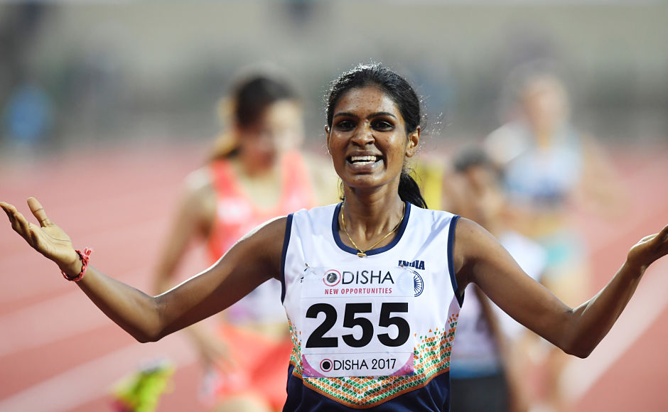 Archana Adhav celebrates after winning gold in the women's 800m. However, she was disqualified for pushinh an opponent during the race.  AFP