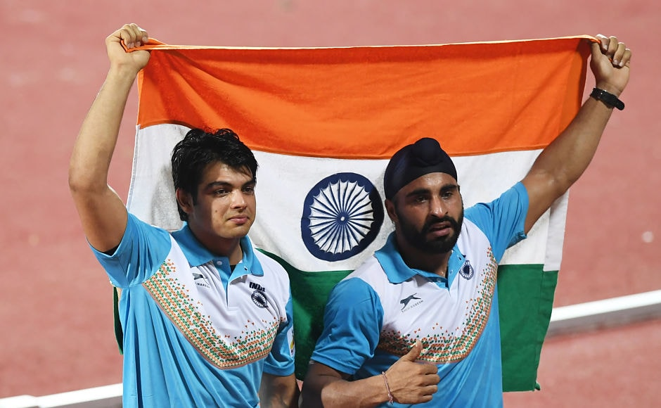 Neeraj Chopra (L) and Davinder Singh Kang celebrate after placing first and third, respectively, in the javelin throw event. AFP