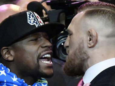 Floyd Mayweather and Conor McGregor during a face off. AFP