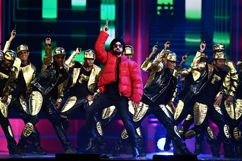 Bollywood actor/singer Diljit Dosanjh performs on stage durig IIFA award of the 18th International Indian Film Academy (IIFA) Festival at the MetLife Stadium in East Rutherford, New Jersey, on July 15, 2017. / AFP PHOTO / JEWEL SAMAD