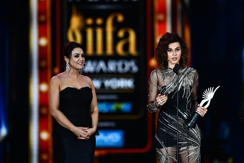 Bollywood actress Taapsee Pannu (R) accepts Women of the Year award as Preity Zinta looks on during IIFA award of the 18th International Indian Film Academy (IIFA) Festival at the MetLife Stadium in East Rutherford, New Jersey, on July 15, 2017. / AFP PHOTO / JEWEL SAMAD