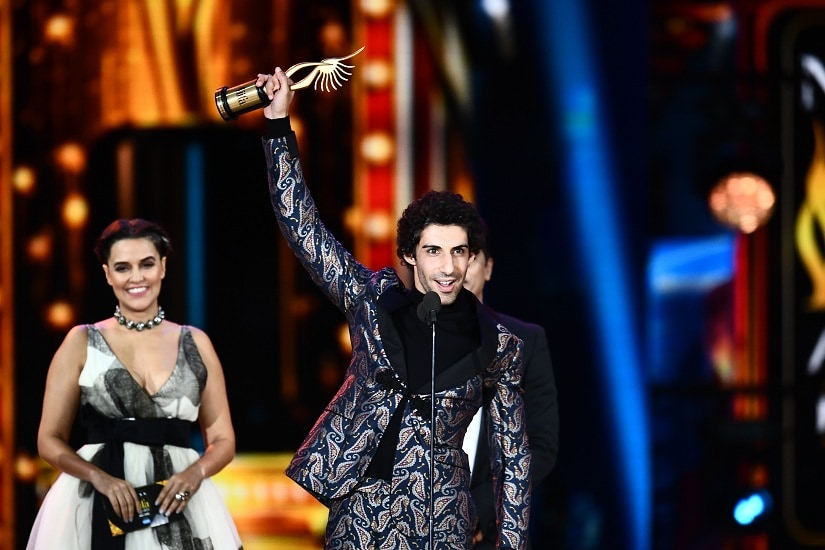 """Winner of Performance in a Negative Role, Jim Sarbh for """"Neerja"""" accepts the award during the 18th International Indian Film Academy (IIFA) Festival at the MetLife Stadium in East Rutherford, New Jersey, on July 15, 2017. / AFP PHOTO / JEWEL SAMAD"""