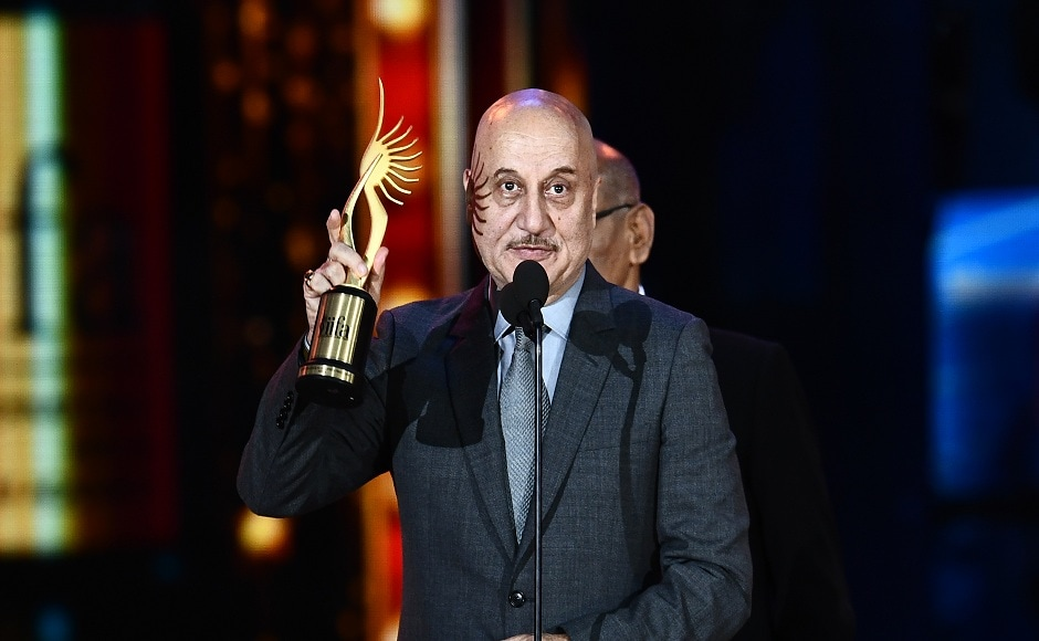 """Winner of Performance in a Supporting Role - Male, Bollywood actor Anupam Kher for """"M.S. Dhoni"""" accepts the award during 18th International Indian Film Academy (IIFA) Festival at the MetLife Stadium in East Rutherford, New Jersey, on July 15, 2017. / AFP PHOTO / JEWEL SAMAD"""