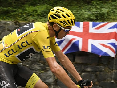 Christopher Froome, rides past an UK Union Jack flag during the 183 km seventeenth stage of Tour de France. AFP