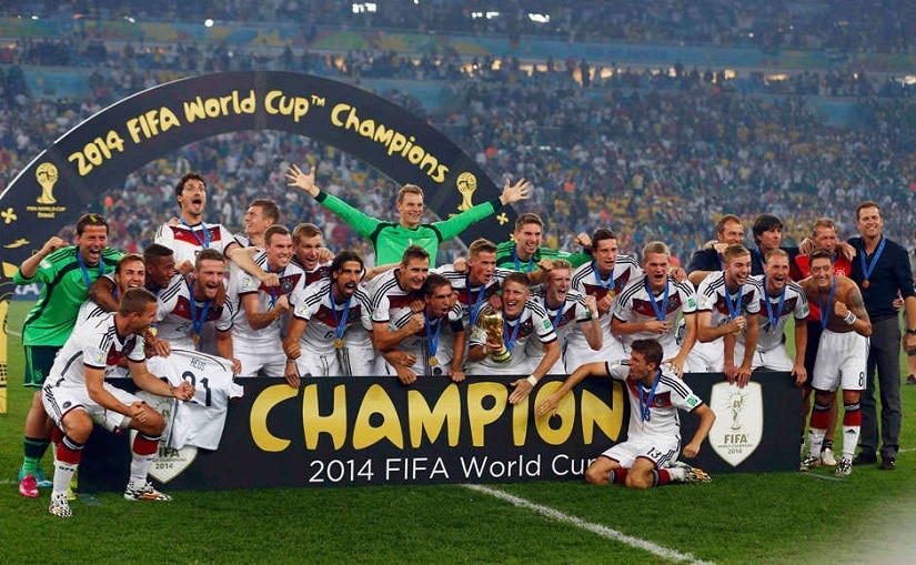 Germany's players pose for pictures as they celebrate with their World Cup trophy after winning their 2014 World Cup final against Argentina at the Maracana stadium in Rio de Janeiro. File Photo/Reuters