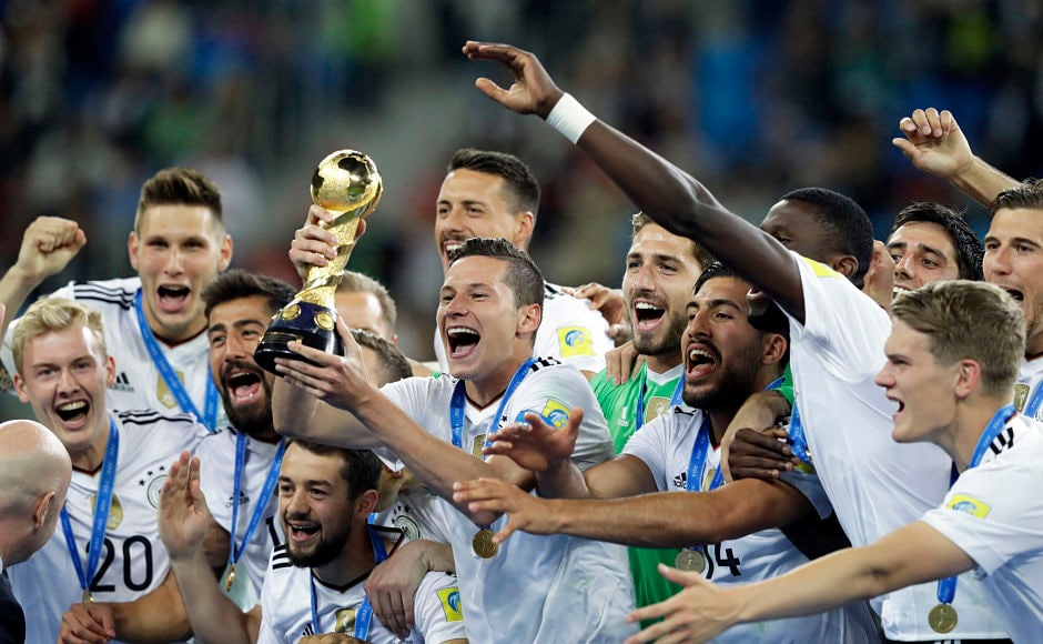 Germany captain Julian Draxler holds the trophy. A 'young' Germany team beat Chile 1-0 to win its maiden Confederations Cup. AP