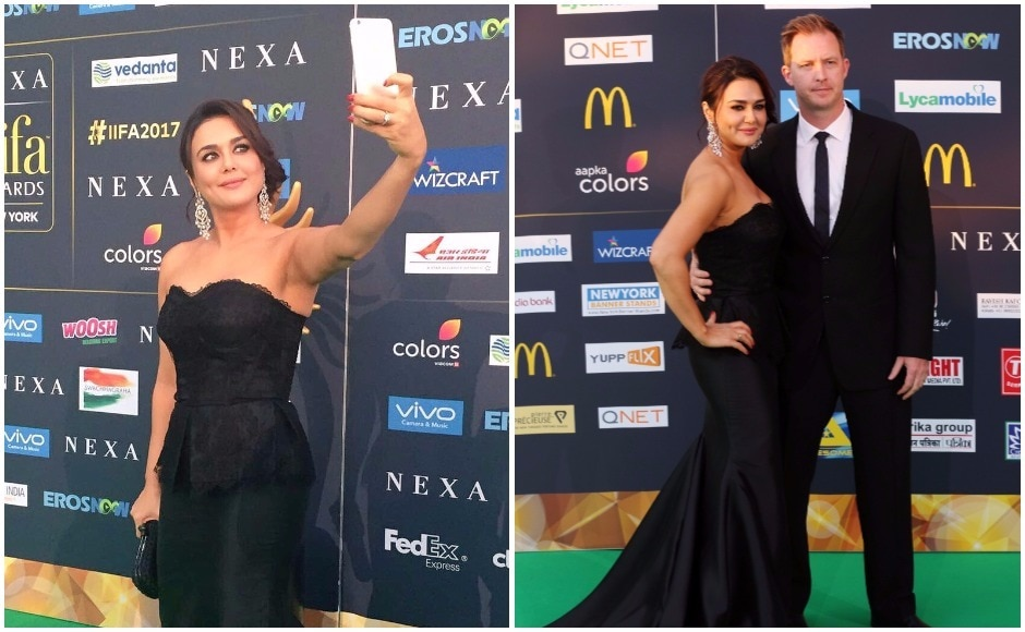 Preity Zinta takes a selfie on the green carpet at the IIFA Awards 2017. IIFA 2017 mars the 18th edition of the Bollywood extravaganza, and is being held in New York City this year. (R) Preity poses with her husband Gene Goodenough on the green carpet. Images via Twitter, Reuters
