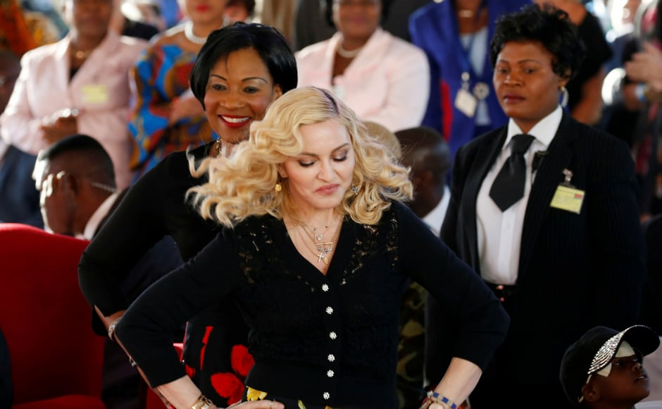 Madonna reacts during the opening of her Mercy James hospital in Blantyre, Malawi. Madonna was in Malawi on Tuesday for the official opening of a hospital children's wing funded by her charity and named after one of the four children the pop star has adopted from the impoverished southern African nation. (Reuters)