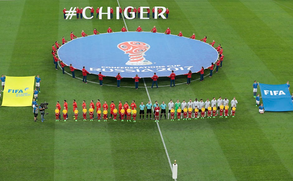 The teams of Chile, left, and Germany stand on the pitch while national anthems are played before the Confederations Cup final football match. Earlier, Chile held the German side to its only draw in the group stage.  AP