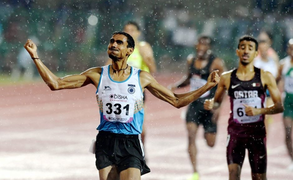 Ajay Kumar Saroj celebrates after winning the gold medal during the Men's 1500m event. PTI