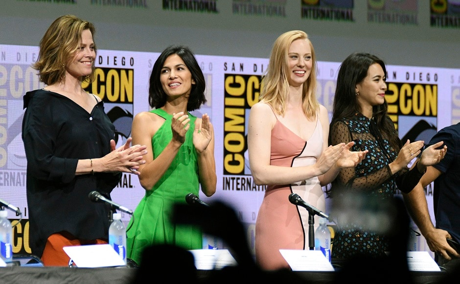 Sigourney Weaver, from left, Elodie Yung, Deborah Ann Woll, and Jessica Henwick applaud on stage at the Marvel's The Defenders panel on day two. Photo by AP
