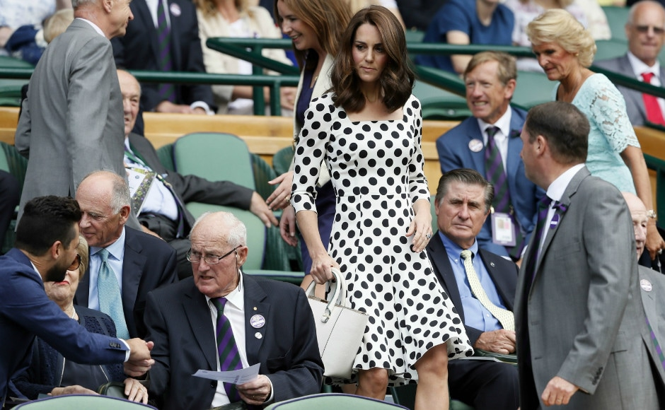 Britain's Kate, the Duchess of Cambridge takes her seat in the Royal Box on the opening day at the Wimbledon Tennis Championships. AP Photo