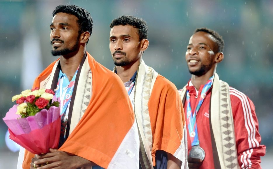India's gold medalist Mohamed Anas Y (Centre) and silver medalist Arokia Rajiv of India (L) along with Ahmed Mubarak of Oman (R) during the medal ceremony of the 400m event. PTI