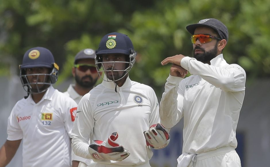 Virat Kohli successfully reviewed a caught-behind appeal and Kusal Mendis had to walk back as Sri Lanka lost their third wicket. AP