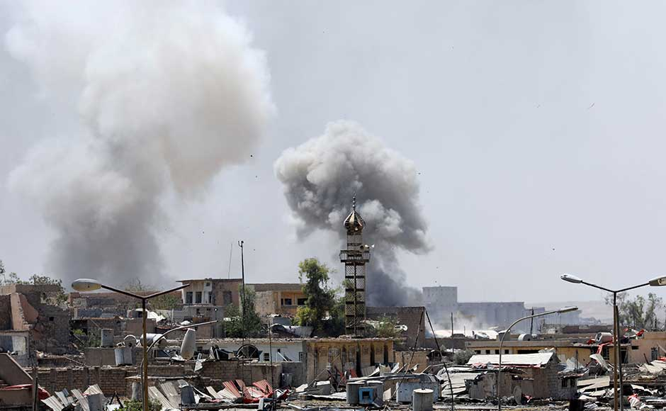 """Smoke billows from militants' positions after an arterial attack. Counter-terrorism forces liberated the Makawi area of the Old City of Mosul, the joint operations command announced on Sunday, in a further blow at the heart of the jihadists' cross-border """"caliphate"""". Reuters"""