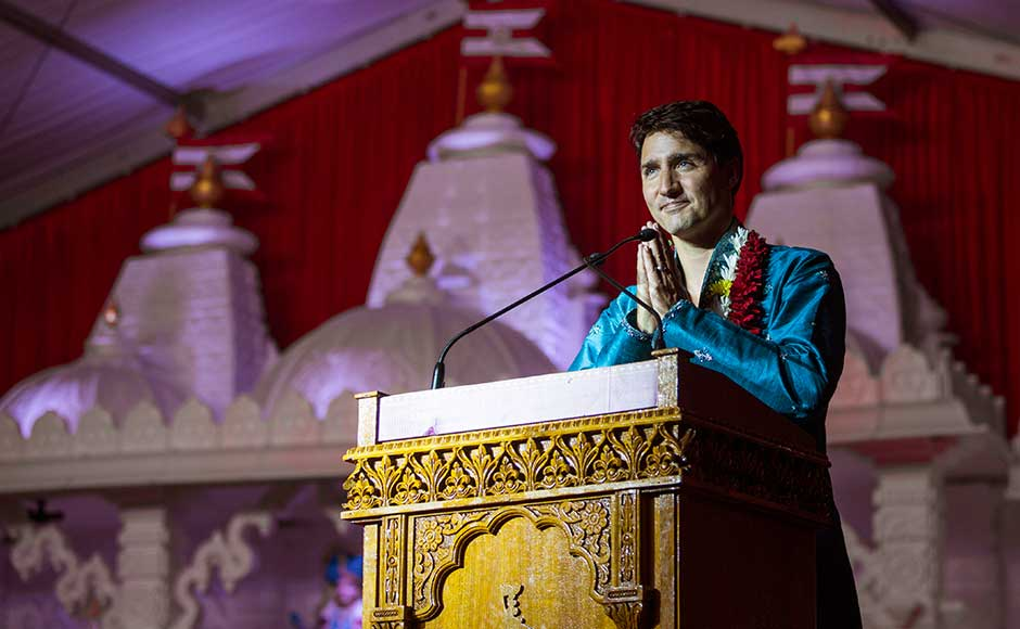 Donning a traditional blue kurta and pajama along with a flower garland draped on his neck, Trudeau participated in the rituals and celebrations in the temple. AP