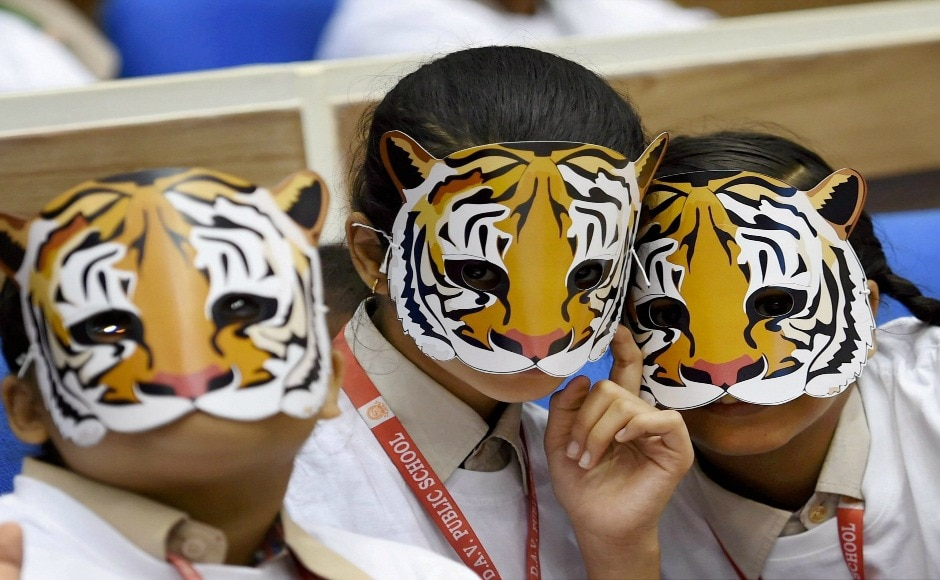 India is currently home to 70 percent of the world's tiger population in over 17 states and 50 sanctuaries across the country. In this picture, students from Delhi celebrate Global Tiger Day by wearing tiger masks. PTI